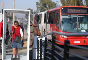 walk-through-sanitising-booth-sprays-south-african-commuters