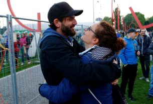 lovers-kept-apart-by-coronavirus-reunited-as-border-fence-comes-down