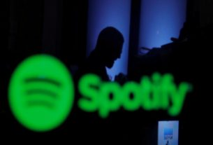spotify-new-home-for-joe-rogan's-podcast,-shares-jump