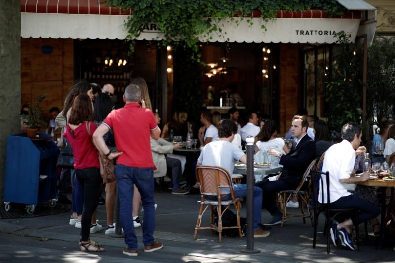 outdoor-seating-only:-parisian-cafes-eke-out-space-along-sidewalks
