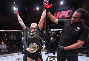 mixed-martial-arts:-dominant-nunes-defeats-spencer-to-defend-featherweight-crown