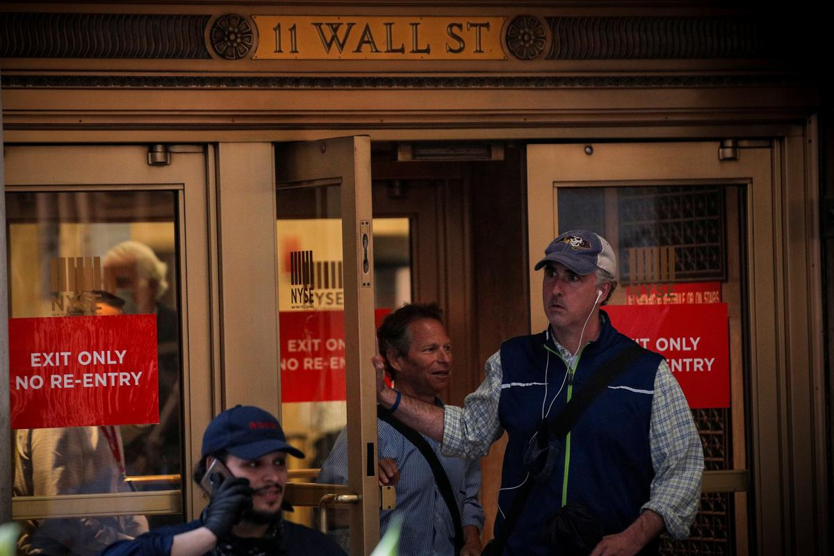 wall-street-closes-higher-as-fed-soothes-recovery-worries