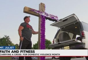 pastor-carries-cross-for-domestic-violence-month