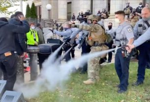 police-use-pepper-spray-to-break-up-a-march-to-a-polling-place-in-north-carolina