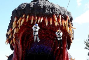 new-japanese-theme-park-attraction-lets-guests-zipline-into-godzilla's-mouth