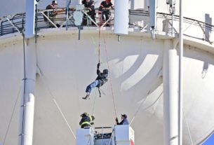 firefighters-rescue-man-from-water-tower