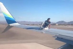man-was-taken-into-custody-after-he-climbed-onto-the-wing-of-an-airplane-preparing-to-takeoff-in-las-vegas