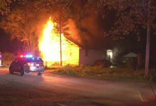 firefighters-rescue-man-from-burning-home