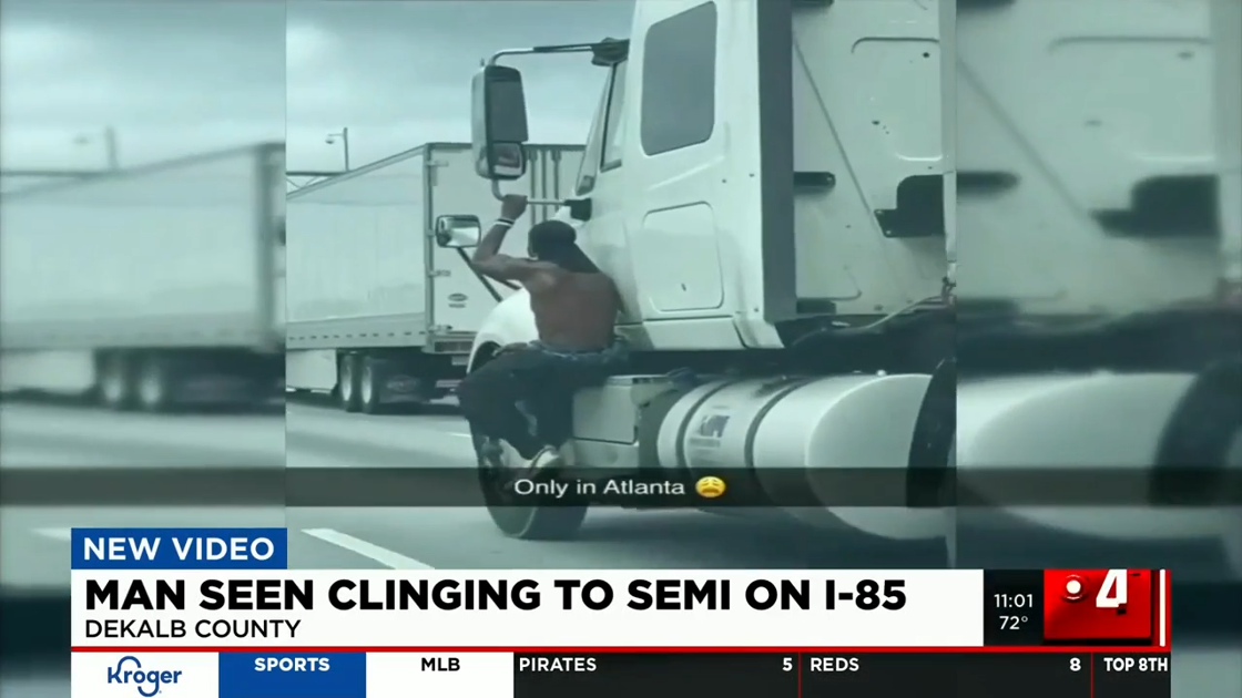 witnesses-describe-seeing-man-clinging-to-semi